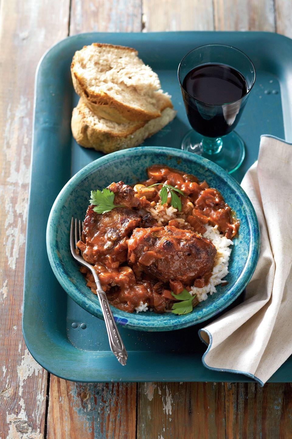 """<p><strong>Recipe:</strong> <a href=""""http://www.myrecipes.com/recipe/wine-braised-oxtails-50400000126178/"""" rel=""""nofollow noopener"""" target=""""_blank"""" data-ylk=""""slk:Wine-Braised Oxtails"""" class=""""link rapid-noclick-resp""""><strong>Wine-Braised Oxtails</strong></a></p> <p>Slow cooking oxtails (beefy cuts from the tail of a cow) with red wine and aromatic vegetables releases their rich flavor, creating a hearty, fork-tender stew that's guaranteed to take the chill off a cold winter's evening.</p>"""