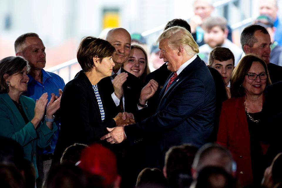 President Donald Trump shakes hands with Iowa Gov. Kim Reynolds while visiting the Southwest Iowa Renewable Energy ethanol plant in Council Bluffs, Iowa, on June 11.