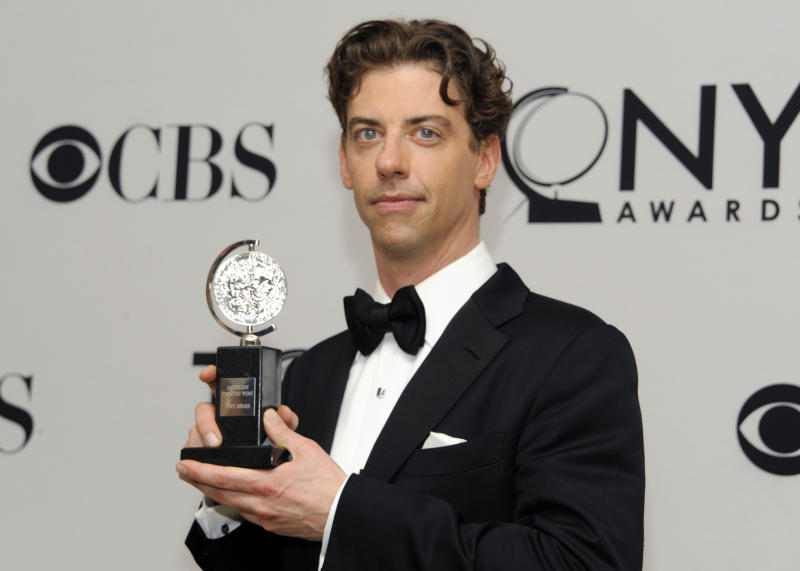 Christian Borle poses backstage with his award at the 66th Annual Tony Awards on Sunday June 10, 2012, in New York. (Photo by Evan Agostini /Invision/AP)