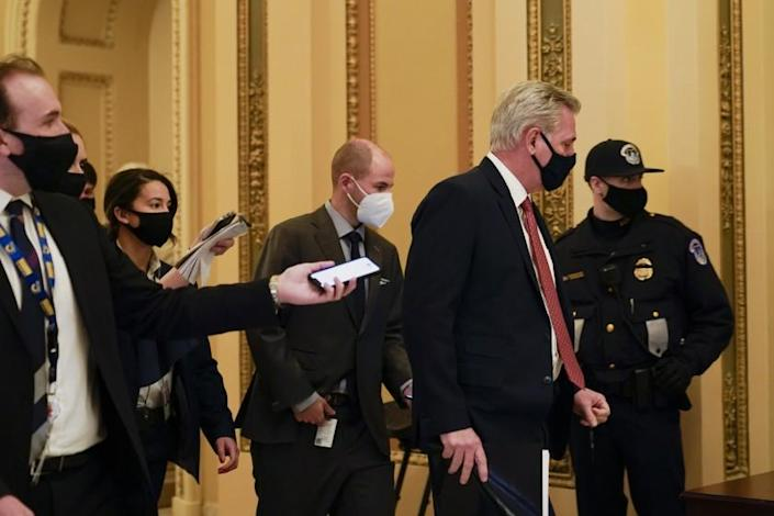 House Minority leader Kevin McCarthy of Calif., is followed by reporters as he heads to the House chamber on Capitol Hill in Washington, Wednesday, jan. 13, 2021. (AP Photo/Susan Walsh)