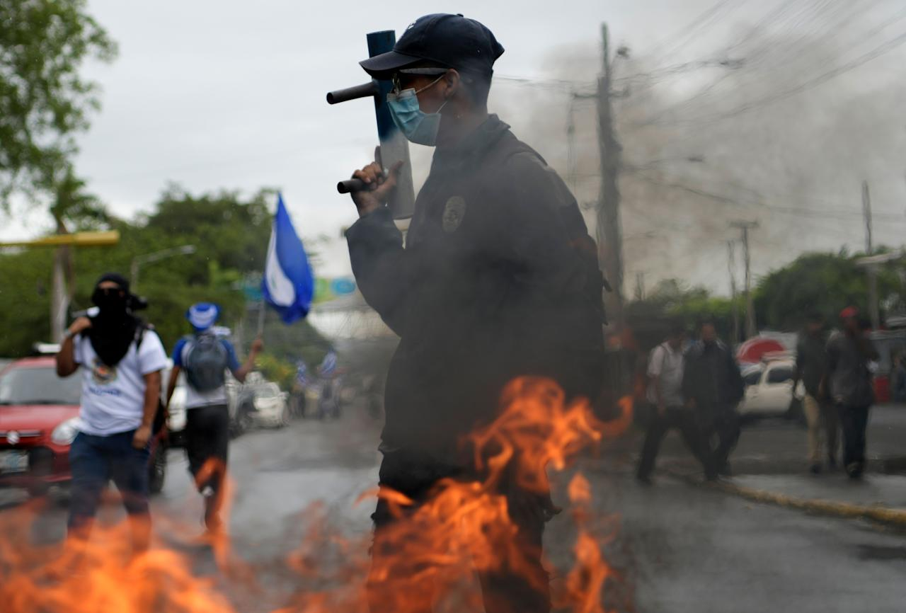 <p>A student takes part in a demonstration by students from different universities from across Nicaragua demanding that President Daniel Ortega and his powerful vice president, wife Rosario Murillo, resign and that the government to keep the 6 percent budget for universities, in Managua, on Aug. 2, 2018. (Photo: Marvin Recinos/AFP/Getty Images) </p>