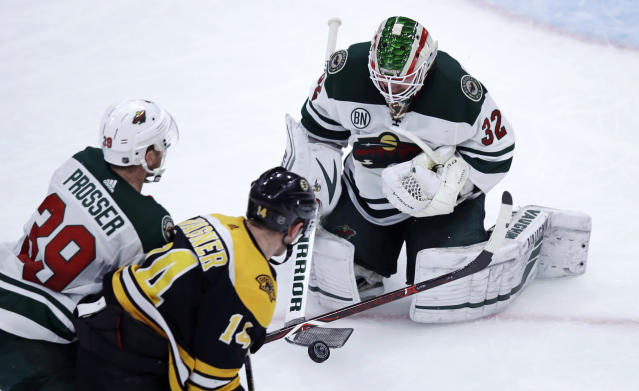 Minnesota Wild goaltender Alex Stalock (32) makes a stick save as Boston Bruins right wing Chris Wagner (14) looks for the rebound during the third period of an NHL hockey game in Boston, Tuesday, Jan. 8, 2019. At left is Wild defenseman Nate Prosser (39). (AP Photo/Charles Krupa)
