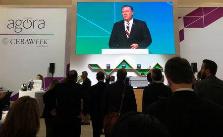 Attendees at IHS Markit's CERAWeek conference watch the keynote address by U.S. Secretary of State Mike Pompeo from the George Brown Convention Center in Houston, Texas, U.S. March 12, 2019.   Picture taken March 12, 2019.  REUTERS/David Gaffen