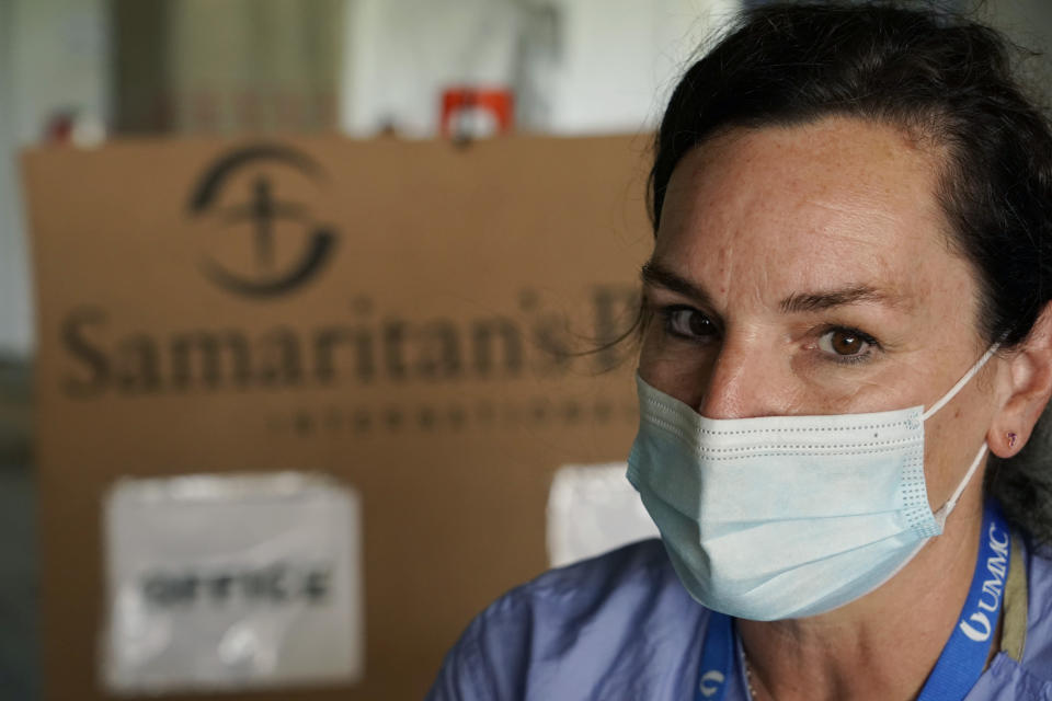 Kelly Sites, a nurse and team leader with the Samaritan's Purse International Relief medical team in Jackson, Miss., speaks of the group's medical missions and how it has affected her, Wednesday, Aug. 25, 2021. Sites has been deployed 22 medical missions with the nondenominational evangelical Christian organization that provides spiritual and medical aid internationally and domestically. (AP Photo/Rogelio V. Solis)