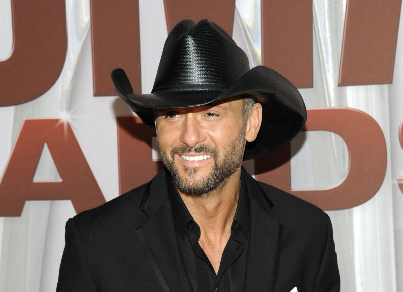FILE - In this Nov. 9, 2011 file photo, country singer Tim McGraw arrives at the 45th Annual CMA Awards in Nashville, Tenn. McGraw and Miranda Lambert are the top nominees for this year's Academy of Country Music Awards. Lambert and McGraw are up for seven awards apiece at the April 6 awards show. The nominations were announced Wednesday morning in a series of videos via social media. (AP Photo/Evan Agostini, file)