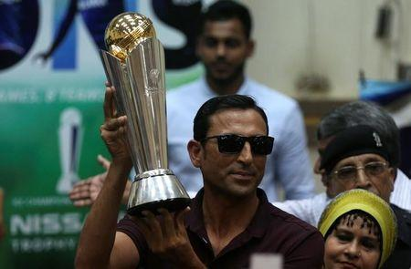 Pakistan's former cricket captain Younis Khan displays the 2017 ICC Champions Trophy during a ceremony at the University of Karachi