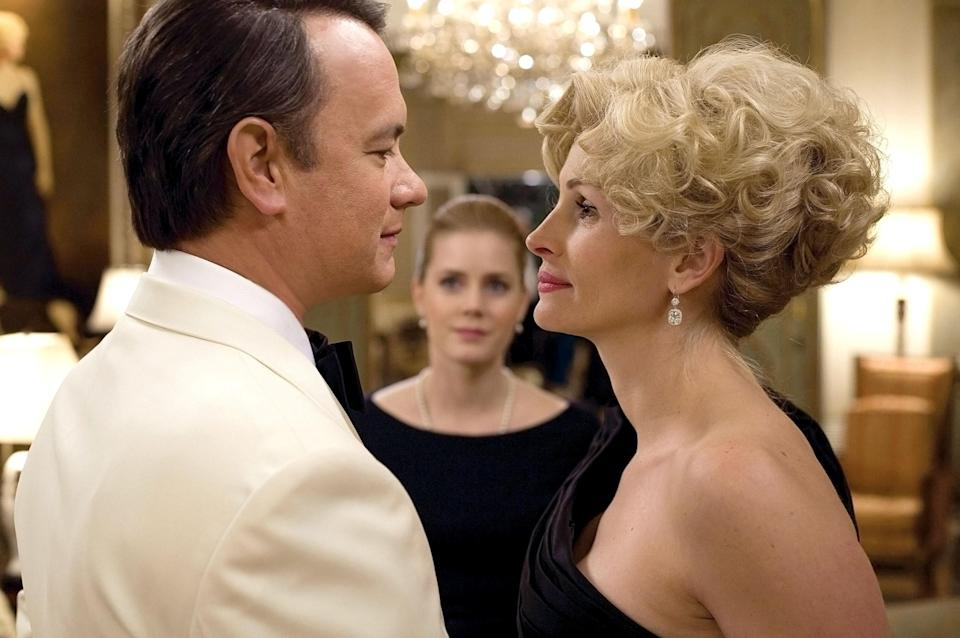 <p>This comedic crime drama is packed with star power. Philip Seymour Hoffman appears alongside Tom Hanks, Amy Adams, and Julia Roberts. Hanks leads as Texas congressman Charlie Wilson, who formed an allegiance with Texas socialite Joanne Herring (Roberts) and CIA agent Gust Avrakotos (Hoffman) to raise funds for Afghan freedom fighters in their war against the Soviet Union. The unlikely tale is based on a true story.</p> <p><em>Available to rent on Amazon Prime Video</em></p>