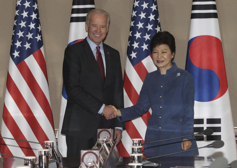 South Korean President Park Geun-hye, right, shakes hands with U.S. Vice President Joe Biden before their meeting at the presidential Blue House in Seoul, South Korea, Friday, Dec. 6, 2013. (AP Photo/Ahn Young-joon. Pool)