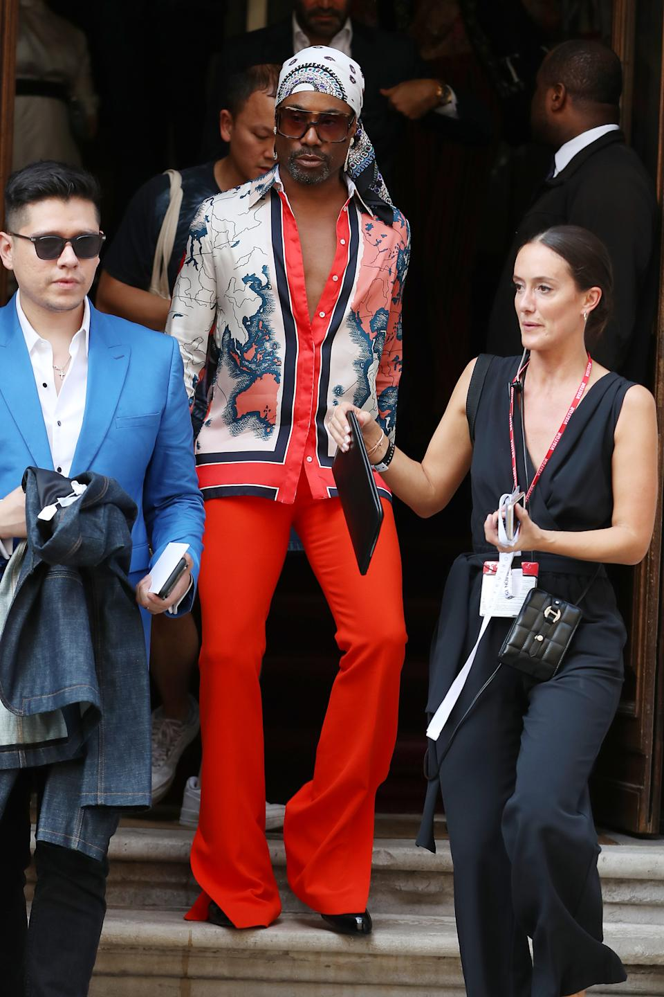 Billy Porter arrived wearing a pair of statement red trousers and a patterned shirt [Photo: Getty]