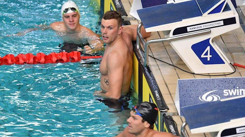 Kyle Chalmers (c) dominated his 100m freestyle heat at the world swimming trials in Brisbane