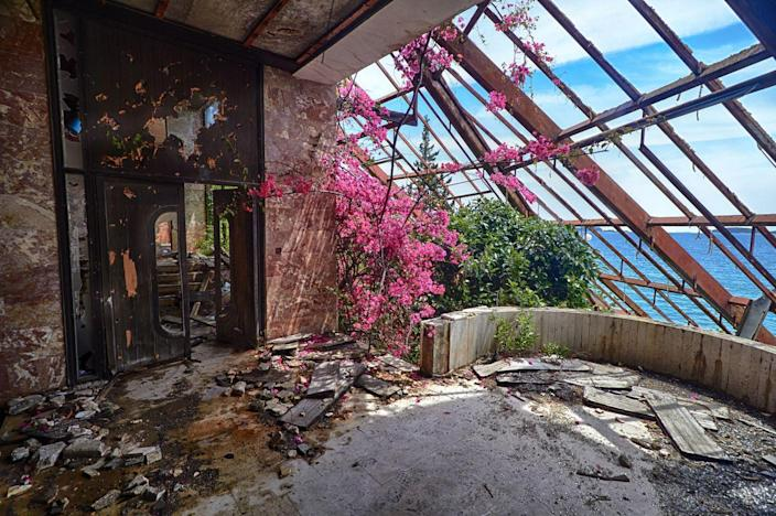 <p>Bougainvillea and the Adriatic sea rule in this abandoned hotel on the Croatian coast. Hotel Goricina was once a luxe hotel in a Yugoslavian military resort, which was destroyed in the Croatian War of Independence, along with a string of other hotels. </p>