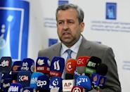Judge Jalil Adnan Khalaf, chairman of Iraq's Independent High Electoral Commission, holds a press conference on October 11, 2021, announcing that partial election results were available (AFP/Sabah ARAR)