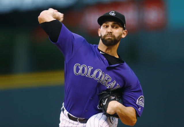 "<a class=""link rapid-noclick-resp"" href=""/mlb/players/8862/"" data-ylk=""slk:Tyler Chatwood"">Tyler Chatwood</a> is heading to Chicago. AP Photo/David Zalubowski)"
