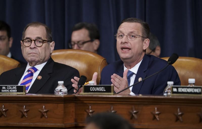 Rep. Doug Collins, R-Ga., the ranking member of the House Judiciary Committee, joined at left by Chairman Jerrold Nadler, D-N.Y., makes his opening statement during a hearing on the constitutional grounds for the impeachment of President Donald Trump, on Capitol Hill in Washington, Wednesday, Dec. 4, 2019. (AP Photo/J. Scott Applewhite)