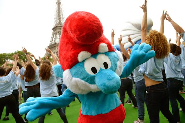 """PARIS, FRANCE - JUNE 22: A performer dressed as the Smurf character """"Papa Smurf"""" takes part to a dance with performers as part of Global Smurfs Day celebrations on June 22, 2013 on the Seine river bank in Paris, France. (Photo by Pascal Le Segretain/Getty Images for Sony Pictures Entertainment)"""