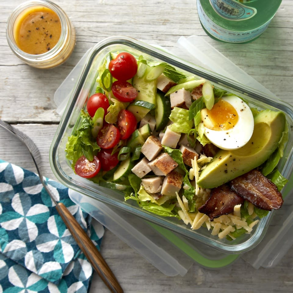 <p>Cubed deli turkey takes the place of chicken, while Cheddar replaces blue cheese in this easy Cobb-inspired salad. The protein-rich turkey and cheese, plus eggs and bacon, gives the salad staying power, so you won't get hungry an hour after you eat. Feel free to swap out the turkey for cooked chicken or chickpeas to mix things up. Serve the salad right away or pack it up in individual containers and you'll be set for lunch for days.</p>