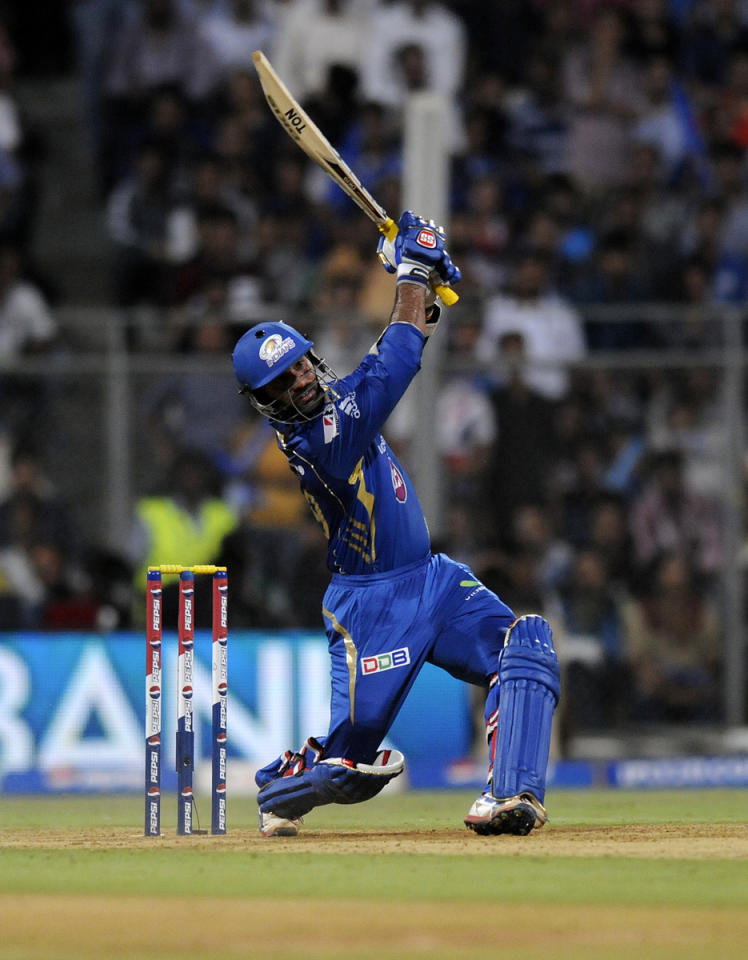 Dinesh Karthik of Mumbai Indians bats during match 53 of the Pepsi Indian Premier League ( IPL) 2013  between The Mumbai Indians and the Kolkata Knight Riders held at the Wankhede Stadium in Mumbai on the 7th May 2013 ..Photo by Pal Pillai-IPL-SPORTZPICS  ..Use of this image is subject to the terms and conditions as outlined by the BCCI. These terms can be found by following this link:..https://ec.yimg.com/ec?url=http%3a%2f%2fwww.sportzpics.co.za%2fimage%2fI0000SoRagM2cIEc.&t=1503229413&sig=3e1hwUbd_OJtHVhLDDh4Xw--~D