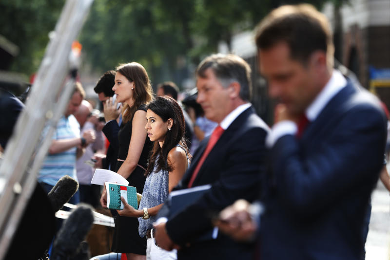 Members of broadcast media give live reports across St. Mary's Hospital exclusive Lindo Wing in London, Monday, July 22, 2013. Buckingham Palace officials say Prince William's wife, Kate, has been admitted to the hospital in the early stages of labour. Royal officials said that Kate traveled by car to St. Mary's Hospital in central London. Kate _ also known as the Duchess of Cambridge _ is expected to give birth in the private Lindo Wing of the hospital, where Princess Diana gave birth to William and his younger brother, Prince Harry.The baby will be third in line for the British throne _ behind Prince Charles and William _ and is anticipated eventually to become king or queen. (AP Photo/Lefteris Pitarakis)