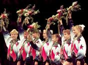 FILE - In this July 23, 1996, file photo, members of the United States women's gymnastics team wave to the crowd after being awarded their gold medals in the team competition at the Centennial Summer Olympic Games in Atlanta. From left are Amanda Borden, Dominique Dawes, Amy Chow, Jaycie Phelps, Dominique Moceanu, Kerri Strug, and Shannon MIller. (AP Photo/John Gaps III, File)