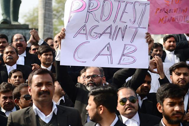 Advocates at the Allahabad High Court take part in a protest against India's new citizenship law in Allahabad on December 17, 2019. - Fresh protests against India's new citizenship law erupted December 17 as alleged police brutality fuelled fury against the legislation which critics say is anti-Muslim. (Photo by SANJAY KANOJIA / AFP) (Photo by SANJAY KANOJIA/AFP via Getty Images)