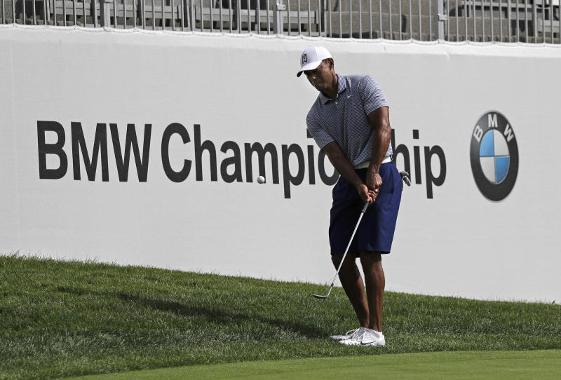 Tiger Woods chips an approach shot on the 12th hole during the pro-am round of the BMW Championship golf tournament at Medinah Country Club, Wednesday, Aug. 14, 2019, in Medinah, Ill. (AP Photo/Nam Y. Huh)