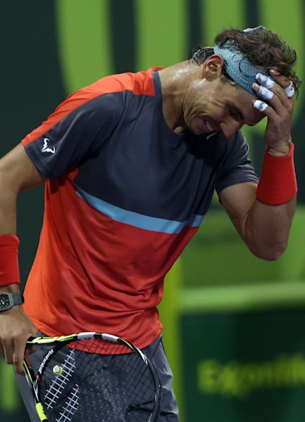 Spain's Rafael Nadal celebrates after winning the final match of the Qatar Open tournament in Doha against France's Gael Monfils on Saturday, Jan. 4, 2014. (AP Photo/Osama Faisal)