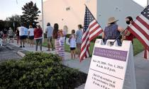 People line up to cast ballots during early voting session in Celebration, Florida