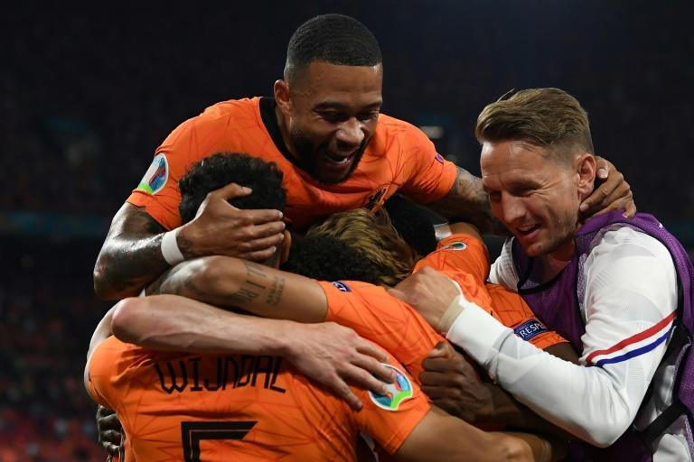 Dumfries (hidden) starred again as the Dutch romped into the knockout phase