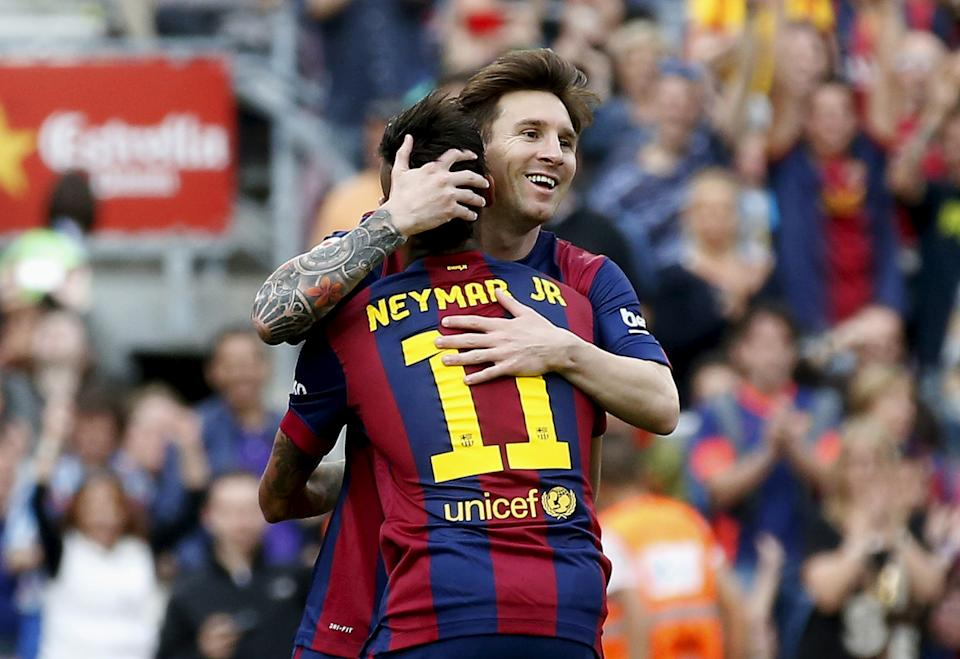 Barcelona's Lionel Messi celebrates his second goal against Deportivo de la Coruna with his team mate Neymar during their Spanish first division soccer match at Nou Camp stadium in Barcelona, Spain, May 23, 2015. REUTERS/Gustau Nacarino TPX IMAGES OF THE DAY