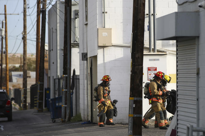 Las Vegas firefighters work the scene of a fire at a three-story apartment complex early Saturday, Dec. 21, 2019 in Las Vegas. The fire was in first-floor unit of the Alpine Motel Apartments and its cause was under investigation, the department said. Authorities say multiple fatalities were reported and several were injured. (Chase Stevens /Las Vegas Review-Journal via AP)