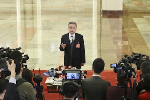 Guo Shuqing, chairman of the China Banking and Insurance Regulatory Commission, has warned of weakening asset quality amid the pandemic. Photo: Xinhua