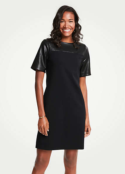 "<p>Trendy and yet still workplace appropriate! This Faux Leather Yoke Ponte Shift Dress has all the classic elements of a shift with leather-look detail around the neckline and sleeves to spice it up. This dress features some added stretch so you'll be comfortable as you take this look from the office to happy hour.<br /><br /><a rel=""nofollow"" href=""https://www.anntaylor.com/faux-leather-yoke-ponte-shift-dress/472113?skuId=25939514&defaultColor=2222&catid=cata000012""><strong>SHOP IT – Ann Taylor $83.97</strong></a> </p>"