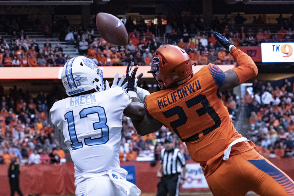 SYRACUSE, NY - OCTOBER 20: Syracuse Orange Defensive Back Ifeatu Melifonwu (23) breaks up a pass intended for North Carolina Tar Heels Wide Receiver Antoine Green (13) during the second half of the game between the North Carolina Tar Heels and the Syracuse Orange on October 20, 2018, at the Carrier Dome in Syracuse, NY.  (Photo by Gregory Fisher/Icon Sportswire via Getty Images)