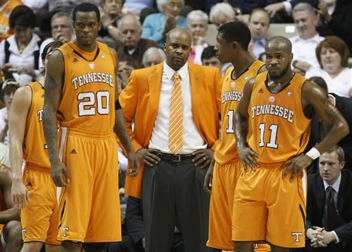 Tennessee head coach Cuonzo Martin, center, watches from the bench along with Kenny Hall (20), Josh Richardson (1) and Trae Golden (11) in the first half of an NCAA college basketball game against Vanderbilt on Tuesday, Jan. 24, 2012, in Nashville, Tenn. (AP Photo/Mark Humphrey)