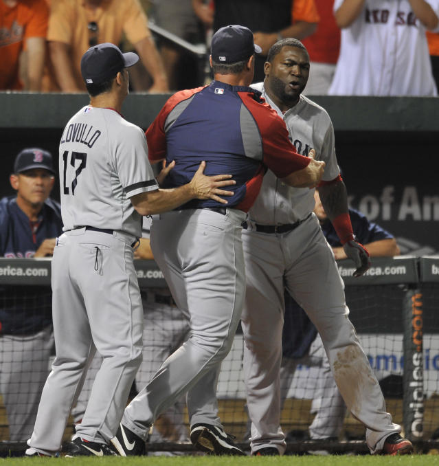 Boston Red Sox designated hitter David Ortiz, right, is held back by manager John Farrell, center, and bench coach Torey Lovullo after being ejected by home plate umpire Tim Timmons in a baseball game against the Baltimore Orioles, Saturday, July 27, 2013, in Baltimore. (AP Photo/Gail Burton)