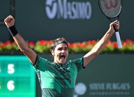 Mar 19, 2017; Indian Wells, CA, USA; Roger Federer (SUI)  celebrates at match point as he defeated Stan Wawrinka (not pictured) 7-6, 6-4 in the men's final in the BNP Paribas Open at the Indian Wells Tennis Garden. Mandatory Credit: Jayne Kamin-Oncea-USA TODAY Sports