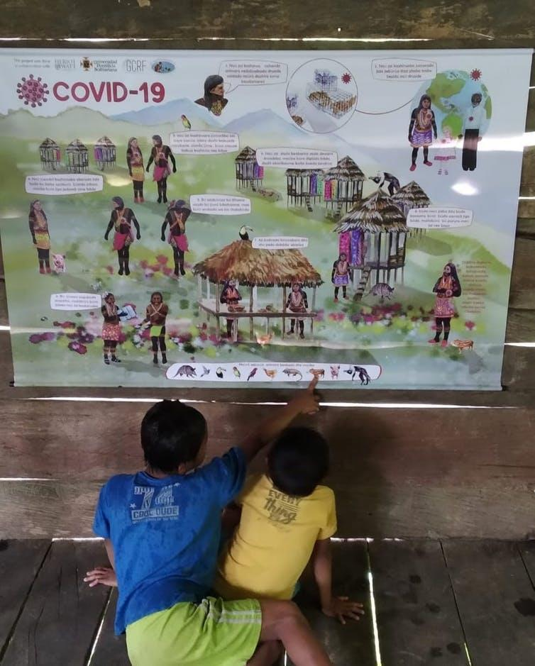 """<span class=""""caption"""">Children's interest in the game aspect of the poster led adults to engage with them about its content and message.</span> <span class=""""attribution""""><span class=""""source"""">Agnessa Spanellis</span>, <span class=""""license"""">Author provided</span></span>"""