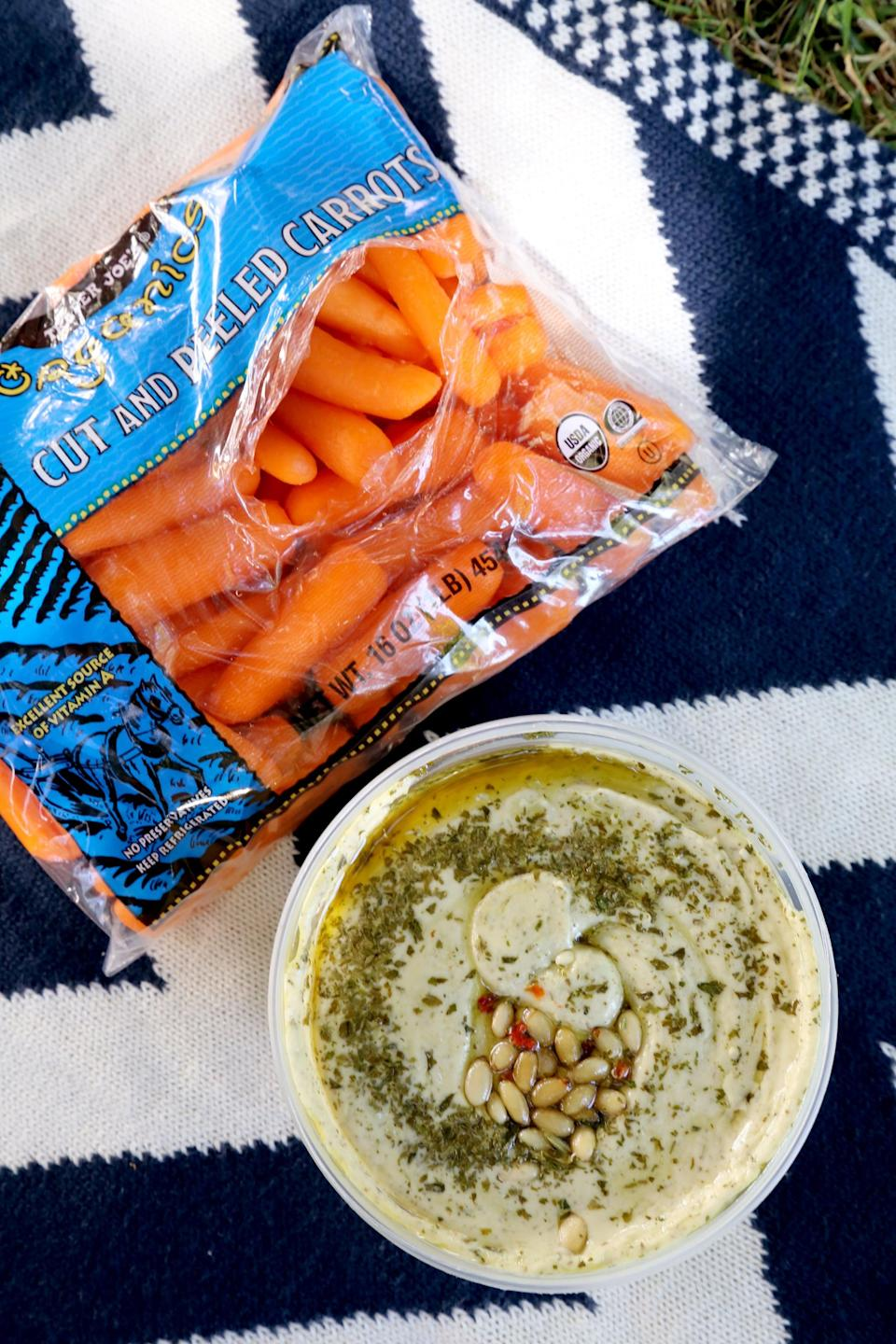 <p>This is hands down our favorite hummus from Trader Joe's, and its large size makes it ideal for serving a crowd. The white beans give the hummus extra creaminess, and the basil flavor is reminiscent of pesto.</p>