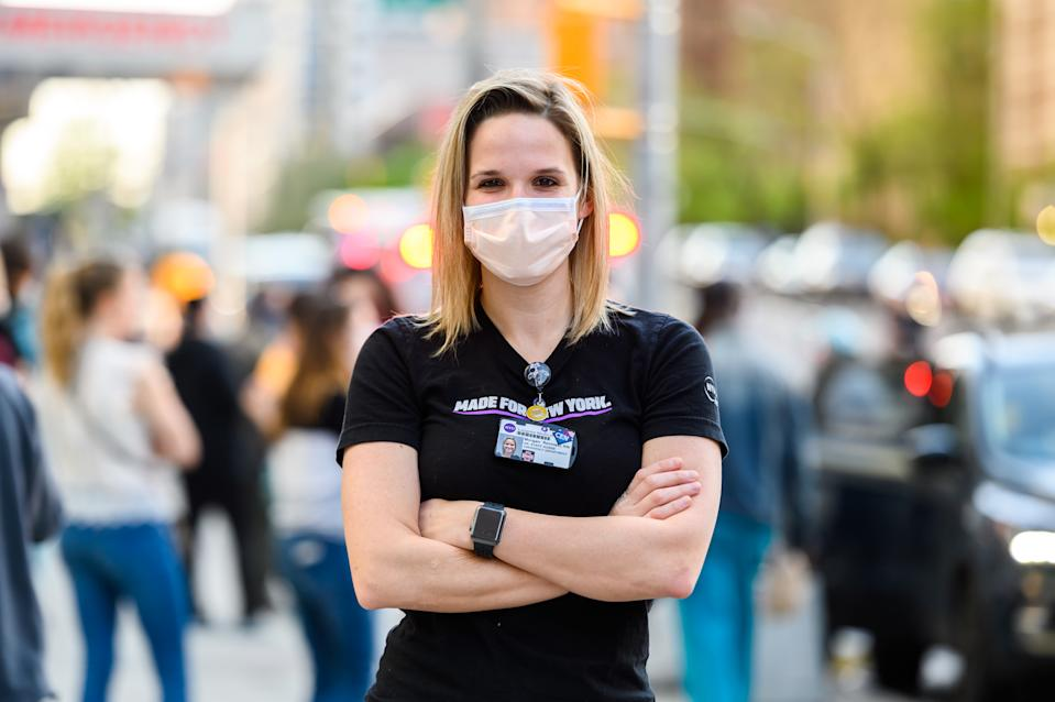 A medical worker poses for a portrait outside NYU Langone Health Hospital as people clap to show their gratitude to medical staff and essential workers during the coronavirus pandemic on May 3, 2020 in New York City.  (Photo: Noam Galai / Getty Images)