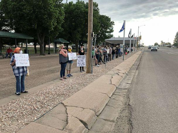 PHOTO: Protesters line up along a street in Yuma, Colorado, during a demonstration in this undated image. (The Yuma Pioneer)