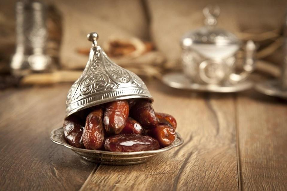 <em>Iftaar</em> is the evening meal with which Muslims end their daily fast. While you can break your fast with any food or drink item, Muslims around the world typically break it with a date to keep with tradition advised by the Prophet Muhammad. After eating a date and drinking some water, Muslims will dive into the actual evening meal, which can include everything from samosas to chicken stew.