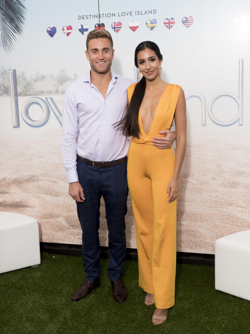 "Josh Moss and Amelia Marni from Australia attend the ""Love Island"" photocall as part of the MIPCOM 2018 on October 15, 2018 in Cannes, France. (Photo by Arnold Jerocki/Getty Images)"