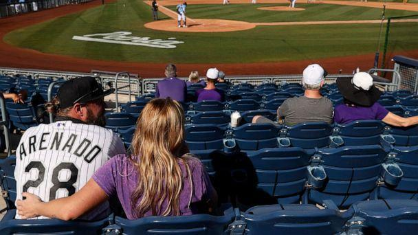 PHOTO: Fans watch an MLB spring training game between the Seattle Mariners and the Colorado Rockies at Peoria Sports Complex on March 04, 2021 in Peoria, Ariz. (Steph Chambers/Getty Images)