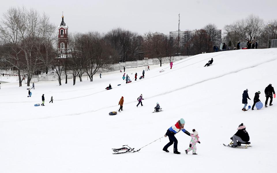Muscovites enjoy the snow during the Christmas holidays. 05 January 2021. Russians are preparing to celebrate the Christmas, which is observed on January 7 according to the Eastern Orthodox Julian calendar. - MAXIM SHIPENKOV/EPA-EFE