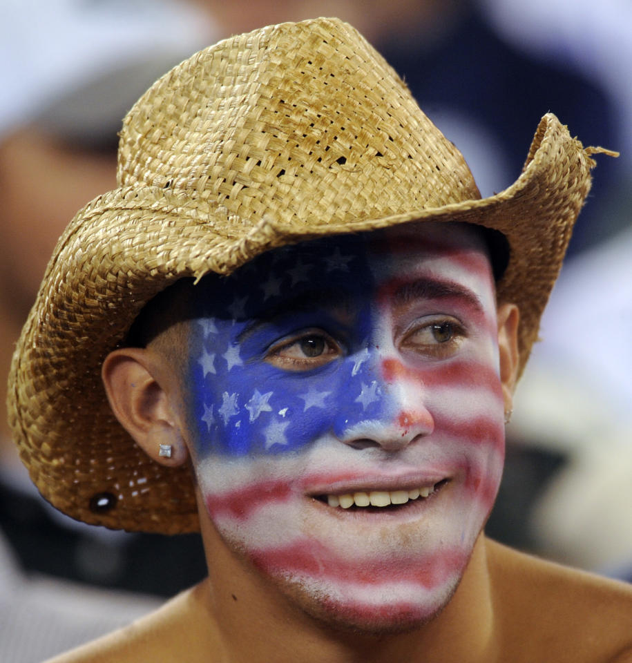 A spectator with an American flag painted on his face watches the first half of an NFL football game between the Dallas Cowboys and the New York Jets Sunday, Sept. 11, 2011, in East Rutherford, N.J. (AP Photo/Henny Ray Abrams)