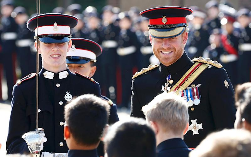 Prince Harry inspects the student guards during his visit to The Duke of York's Royal Military School on September 28, 2015 - Credit: GETTY IMAGES