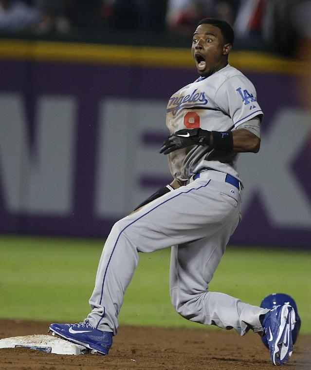 Los Angeles Dodgers' Dee Gordon reacts to being called out after Atlanta Braves shortstop Andrelton Simmons made the tag on his steal-attempt in the ninth inning of Game 2 of the National League division series on Friday, Oct. 4, 2013, in Atlanta. (AP Photo/John Bazemore)