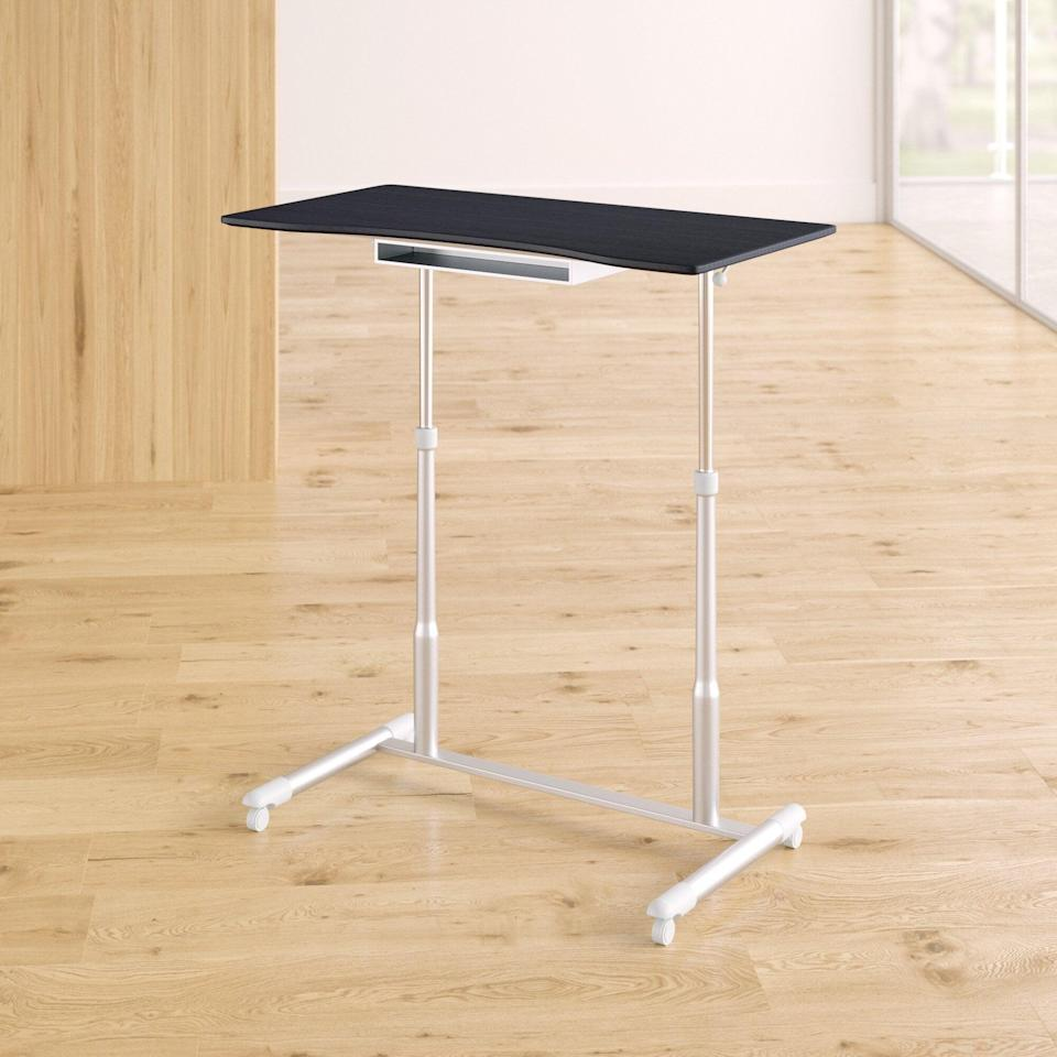 """<h2>Best Standing Desk Under $300</h2><br><h3>Upper Square Albin Height Adjustable Standing Desk</h3><br><strong>The Hype:</strong> 4.3 out of 5 stars and 230 reviews on <a href=""""https://www.wayfair.com/furniture/pdp/upper-square-albin-height-adjustable-standing-desk-w004927495.html"""" rel=""""nofollow noopener"""" target=""""_blank"""" data-ylk=""""slk:Wayfair"""" class=""""link rapid-noclick-resp"""">Wayfair</a><br><br><strong>WFH Heroes Say:</strong> """"The picture online does not give it justice. The adjustable desk was easy to put together, the tabletop is much bigger and wider than I imagined. The espresso color is absolutely beautiful! I have so much space on the tabletop for my laptop and other things. A perfect fit for my stay-at-home-work area.""""<br><br><em>Shop</em> <strong><em><a href=""""https://www.wayfair.com/brand/bnd/upper-square-b51050.html"""" rel=""""nofollow noopener"""" target=""""_blank"""" data-ylk=""""slk:Upper Square"""" class=""""link rapid-noclick-resp"""">Upper Square</a></em></strong><br><br><strong>Upper Square</strong> Albin Height Adjustable Standing Desk, $, available at <a href=""""https://go.skimresources.com/?id=30283X879131&url=https%3A%2F%2Fwww.wayfair.com%2Ffurniture%2Fpdp%2Fupper-square-albin-height-adjustable-standing-desk-w004927495.html"""" rel=""""nofollow noopener"""" target=""""_blank"""" data-ylk=""""slk:Wayfair"""" class=""""link rapid-noclick-resp"""">Wayfair</a>"""