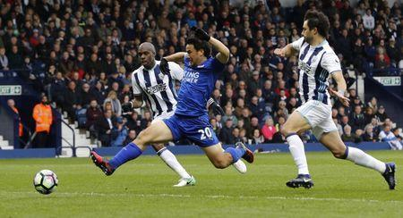 Britain Football Soccer - West Bromwich Albion v Leicester City - Premier League - The Hawthorns - 29/4/17 Leicester City's Shinji Okazaki in action with West Bromwich Albion's Allan Nyom and Claudio Yacob Reuters / Darren Staples Livepic