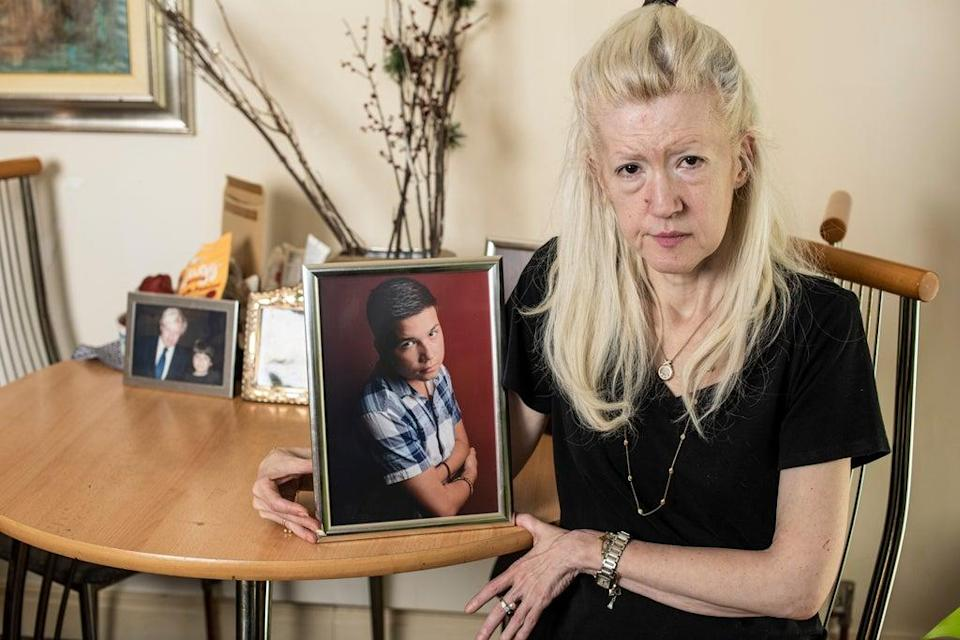 Jasna Badzak with a picture of her son Sven, who was stabbed to death near his home in February (Daniel Hambury/Stella Pictures Ltd)